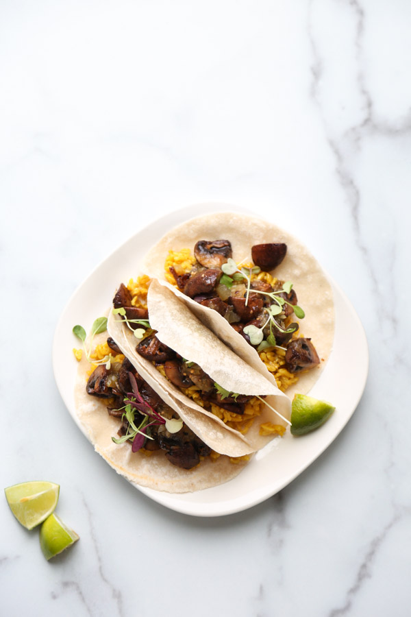 Mexican Mushroom tacos with yellow rice on a plate