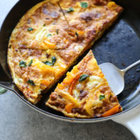 serving slice of frittata from the pan