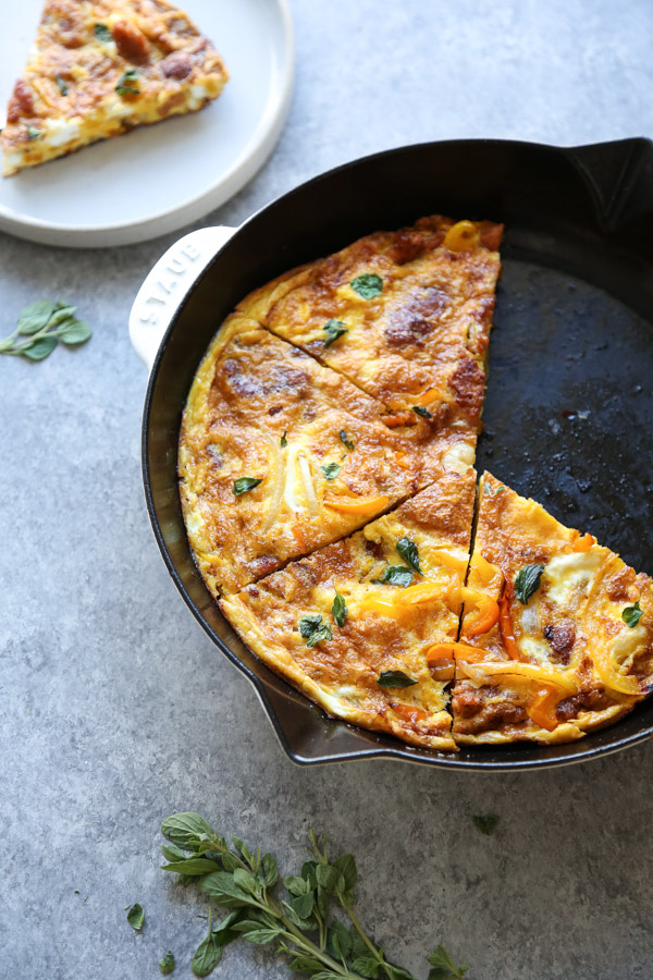 sausage frittata sliced in a skillet