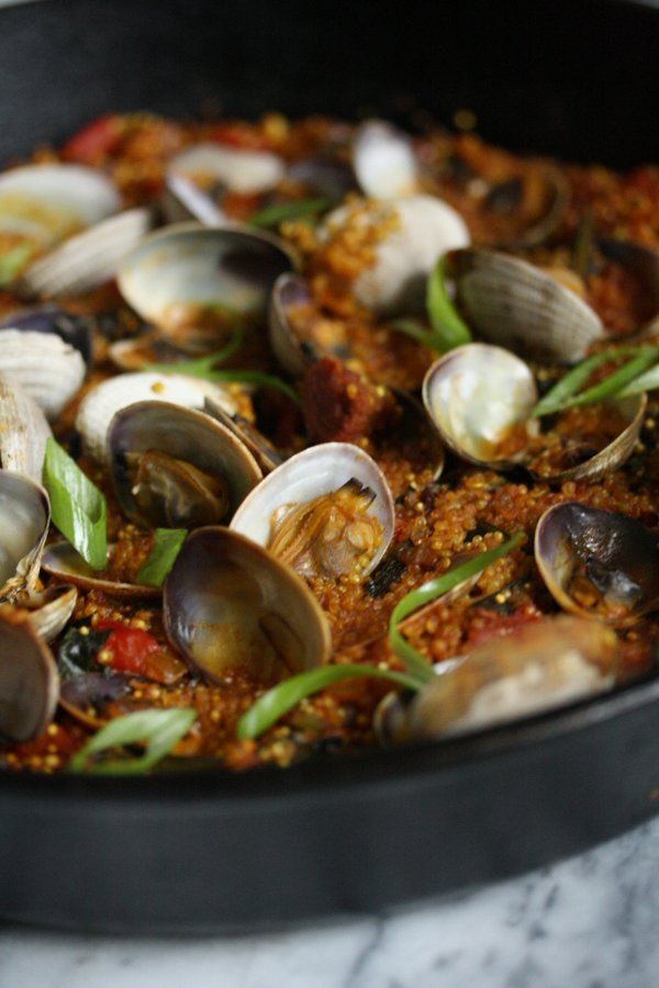 Healthy paella with quinoa and winter greens. Love the combination of chorizo and clams too.