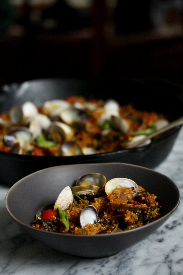 Spanish paella with quinoa recipe - a easy healthy spin on classic paella with quinoa clams and greens.