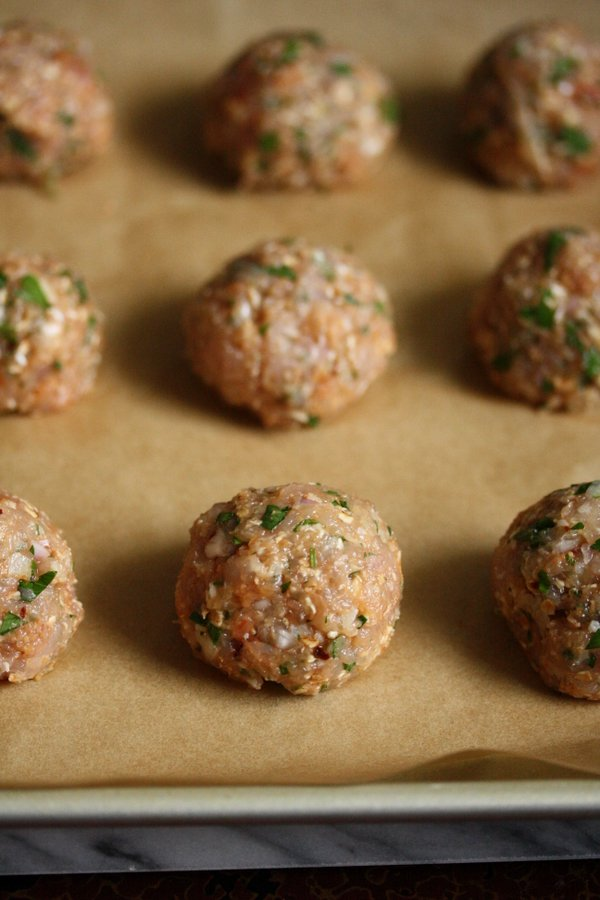 The best baked meatball recipe. Gluten-free and Easy. Made healthy with ground chicken and whole grain oats instead of breadcrumbs.