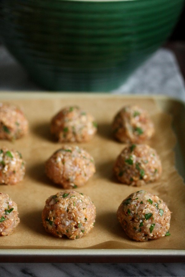 This healthy meatball recipe uses ground chicken and gluten-free oats instead of breadcrumbs in the classic Italian version