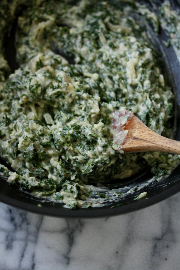 My healthy, gluten-free creamed kale using white bean puree. It's vegan and gluten-free! I use it to stuff mushroom caps for an easy baked appetizer.