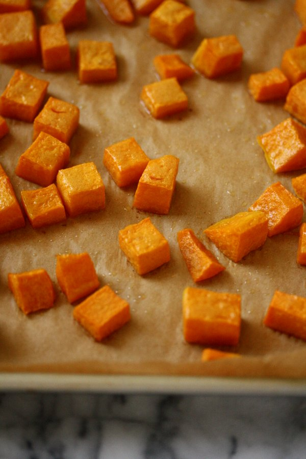roasted butternut squash about to be mashed on toast - my favorite seasonal vegetarian party appetizer