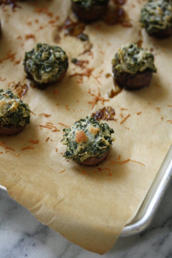 "Healthy Stuffed Mushrooms with ""Creamed"" Kale - a gluten-free white bean puree, baked in the oven with just a little Manchego on top."