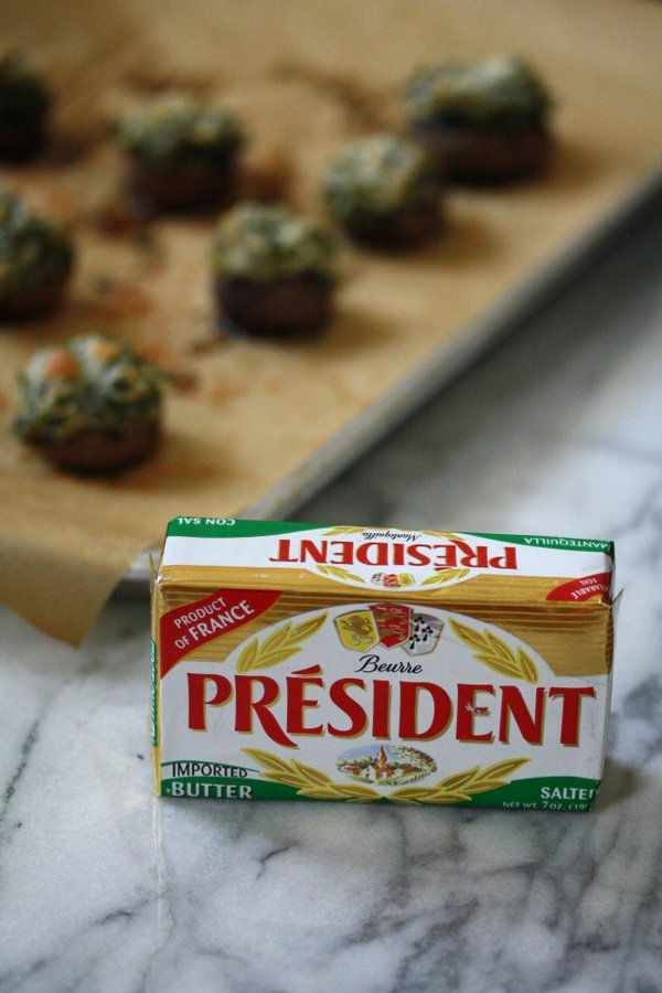Gluten-Free Stuffed Mushroom with a healthy creamed kale in the caps. An easy appetizer for holiday parties!