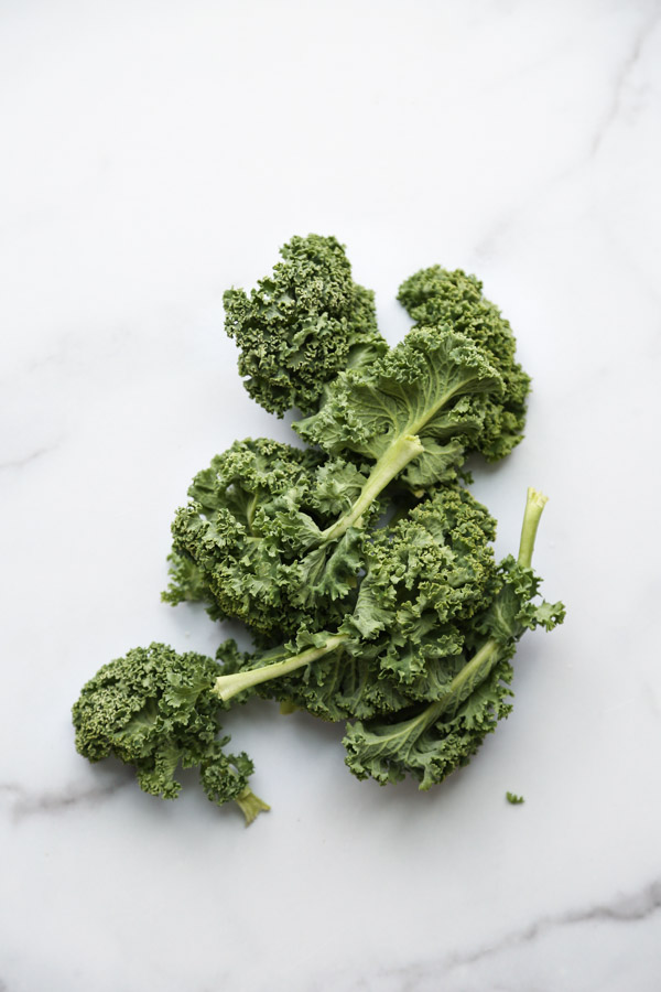 curly kale on a marble board