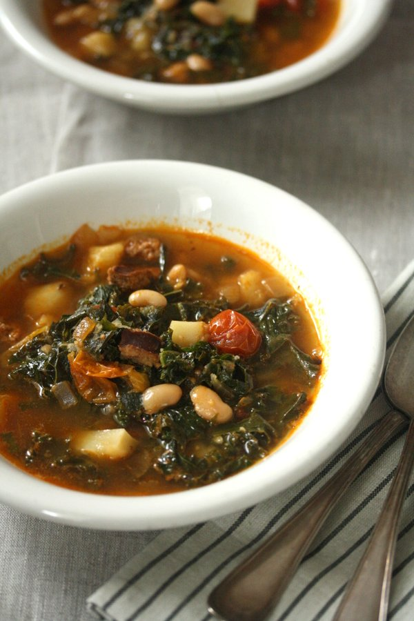 Caldo Verde: This healthy authentic Portuguese kale soup recipe uses smoked linguica, potatoes, beans and cherry tomatoes