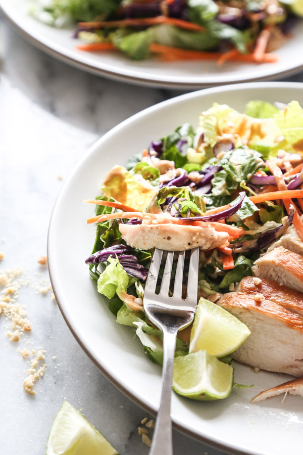 This Easy Asian Chicken Salad Recipe combines carrots, cabbage + romaine with creamy peanut dressing - a crunchy, healthy version of Chinese chicken salad! | www.feedmephoebe.com