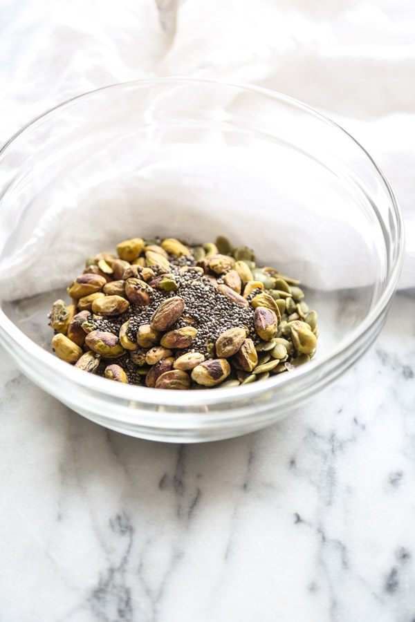 Healthy Pepita Brittle to top Golden Milk Oatmeal | Healthy Breakfast Recipe | www.feedmephoebe.com