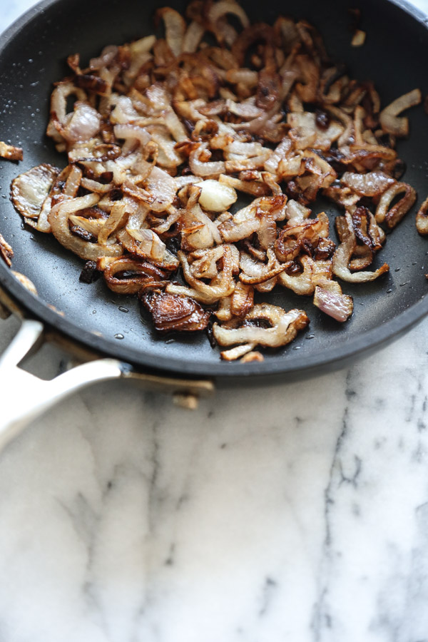 Crispy shallots are the secret ingredient in my collard green salad recipe with grilled shrimp! | www.feemephoebe.com