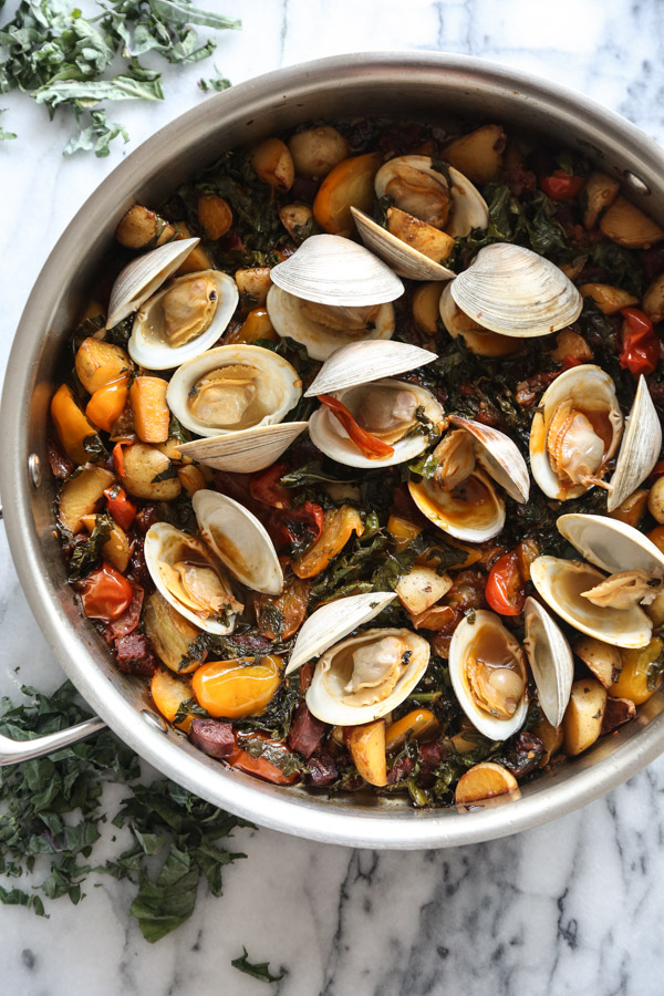Easy Steamed Clams Recipe with Chorizo, Tomatoes, Potatoes, White Wine and Kale | Great as a healthy one pot meal or served over linguine | Feed Me Phoebe