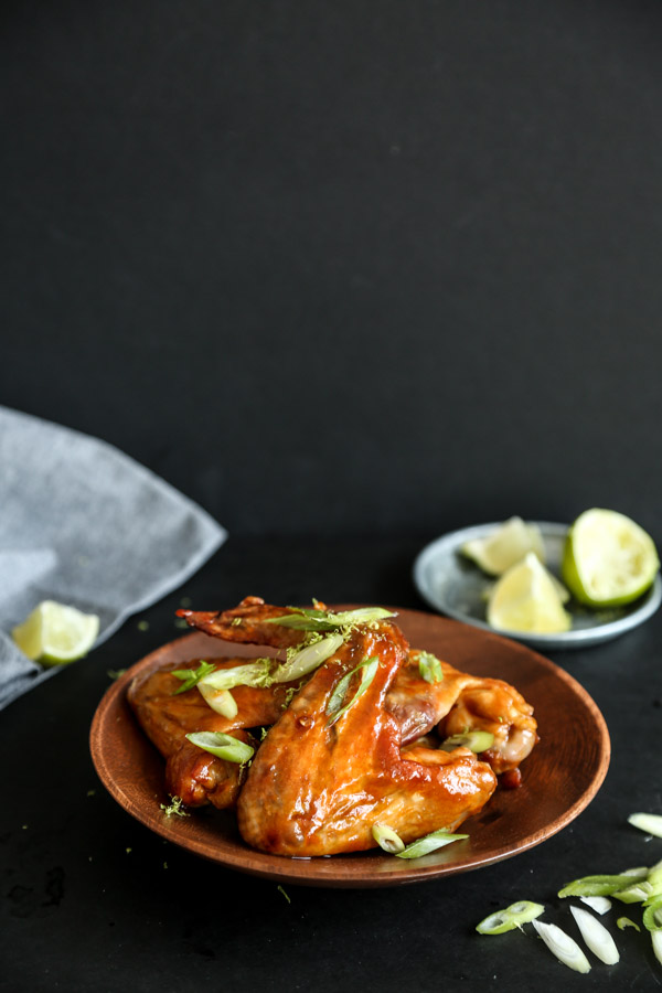 CHIPOTLE HONEY LIME CHICKEN WINGS // this easy baked chicken wings recipe uses the oven to render the skin and make it crispy and healthy(ish). Plus, the honey-lime chipotle sauce has tequila in it! // FEED ME PHOEBE
