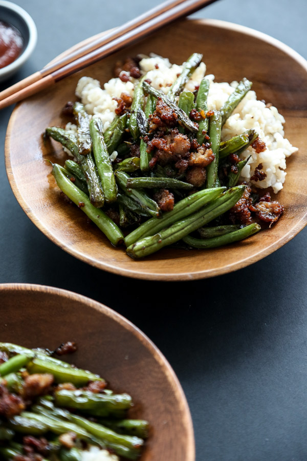 These Chinese stir fry green beans are loaded with spicy chiles, crispy pork, and zesty ginger. The recipe is a great takeout fakeout and just as quick! | FEED ME PHOEBE