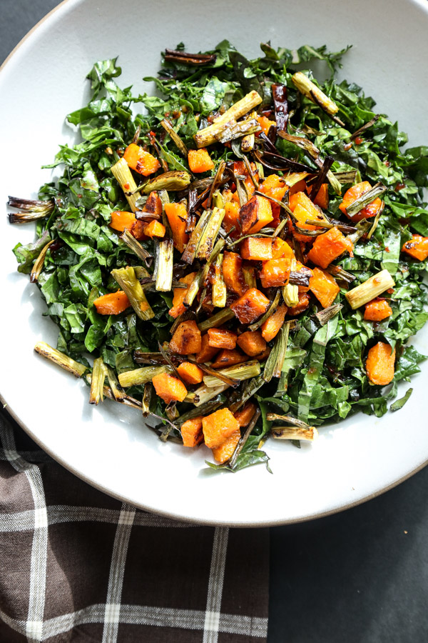 This massaged kale salad recipe is tossed with roasted butternut squash, crispy scallions and a sweet chili dressing. The perfect fall side dish!