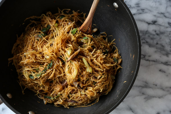 This vegetable chow mein recipe is made gluten-free by using spaghetti squash instead of noodles. It's also packed with bok choy and shitake mushrooms! A great easy weeknight meal | Feed Me Phoebe
