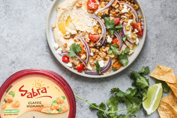 Loaded Southwestern-Style Spicy Hummus with Corn, Cherry Tomatoes, Cilantro and Red Onions | Using @sabra as the base!