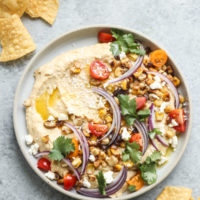 Loaded Southwestern-Style Spicy Hummus with Corn, Cherry Tomatoes, Cilantro and Red Onions | Feed Me Phoebe