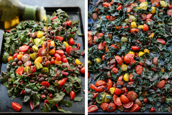 A sheet pan full of cherry tomatoes, olives, chard, puttanesca sauce.