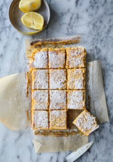 lemon bars cut on a counter