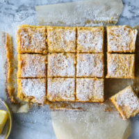 cut lemon bars on a cutting board