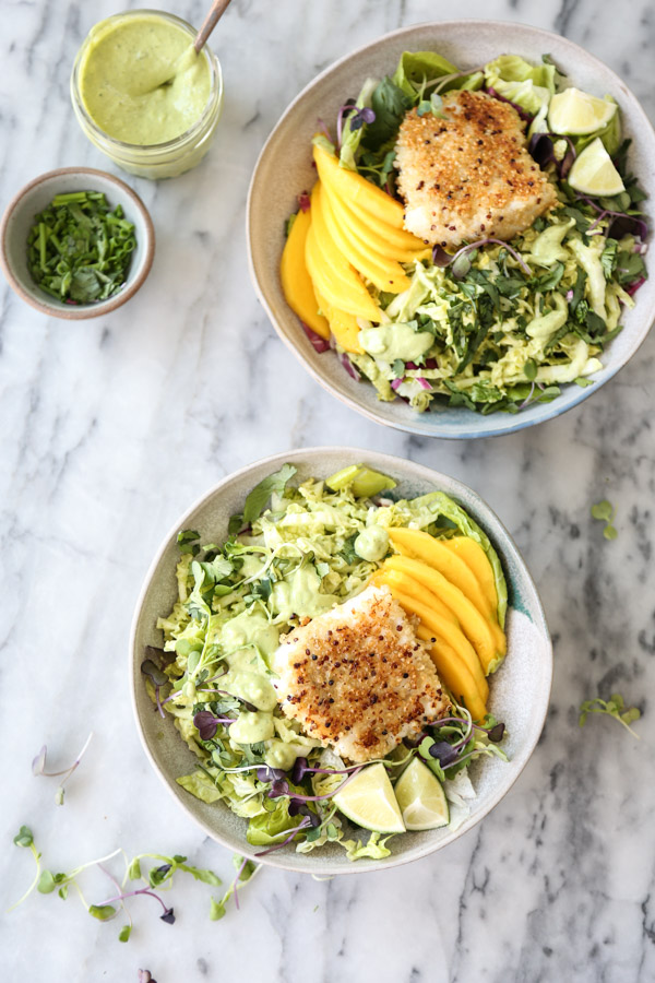 fish tacos in bowls with slaw and mango