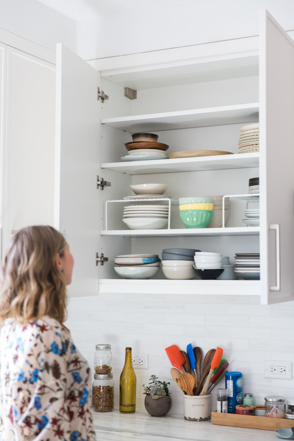 Organizing Your Kitchen How to organize your kitchen cabinets and pantry feed me phoebe plates bowls and dishes on a shelf with organizing risers workwithnaturefo
