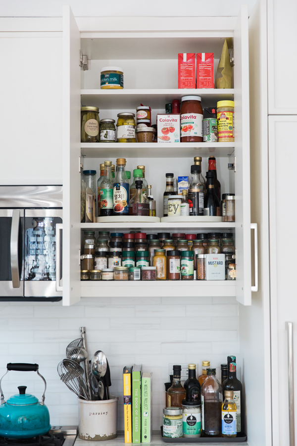 spice rack inside a shelf cabinet