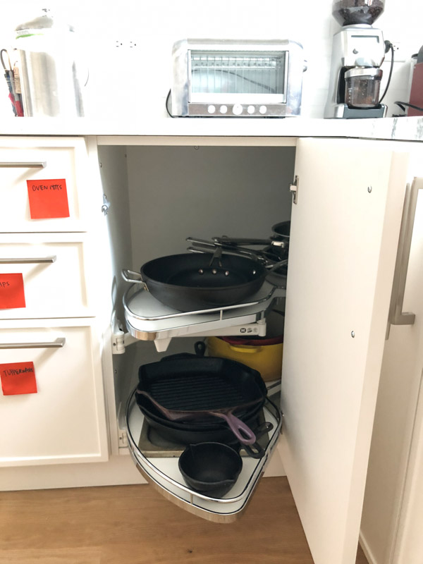 pans in a cabinet organizer