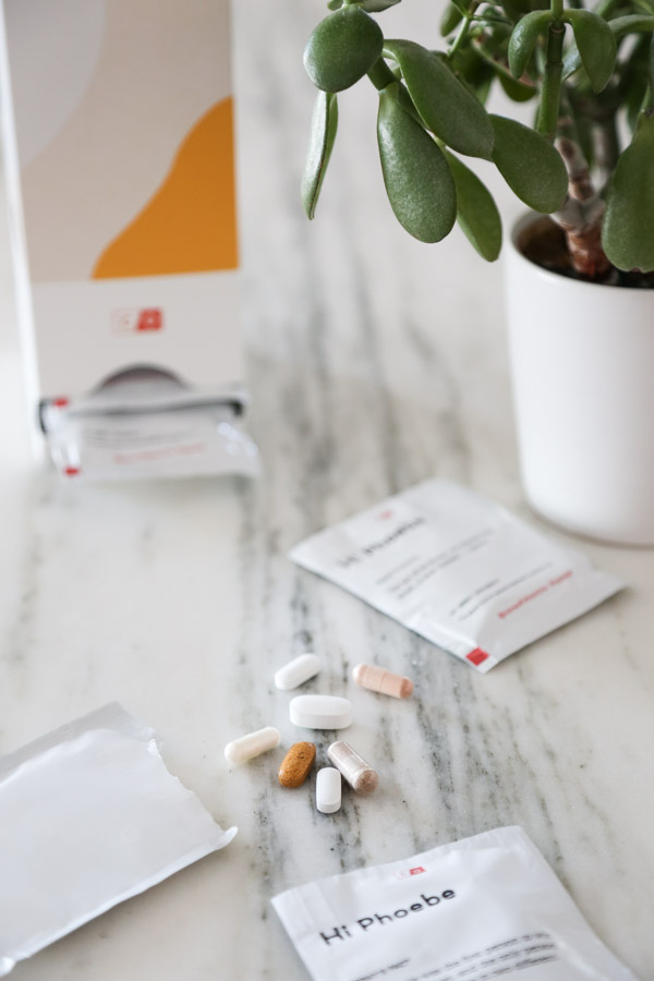 vitamins on counter with care/of packs