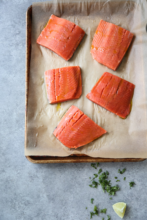 sockeye salmon fillets on a sheet pan with parchment paper