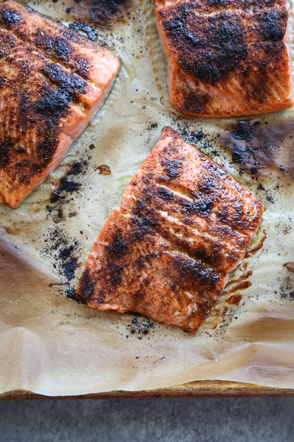 blackened salmon on a sheet pan with parchment paper f