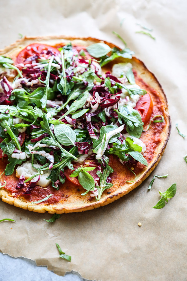 gluten-free salad pizza pie on a board