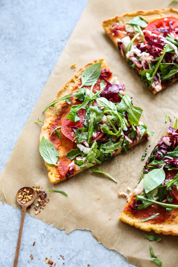 salad pizza slice on a board