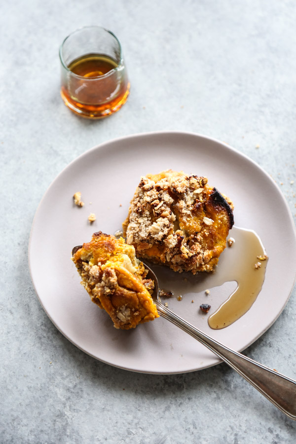 slice of pumpkin french toast with maple syrup on a plate