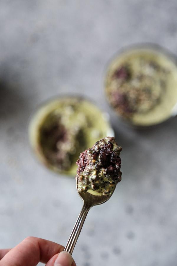 Black rice pudding in a ramekin with spoon