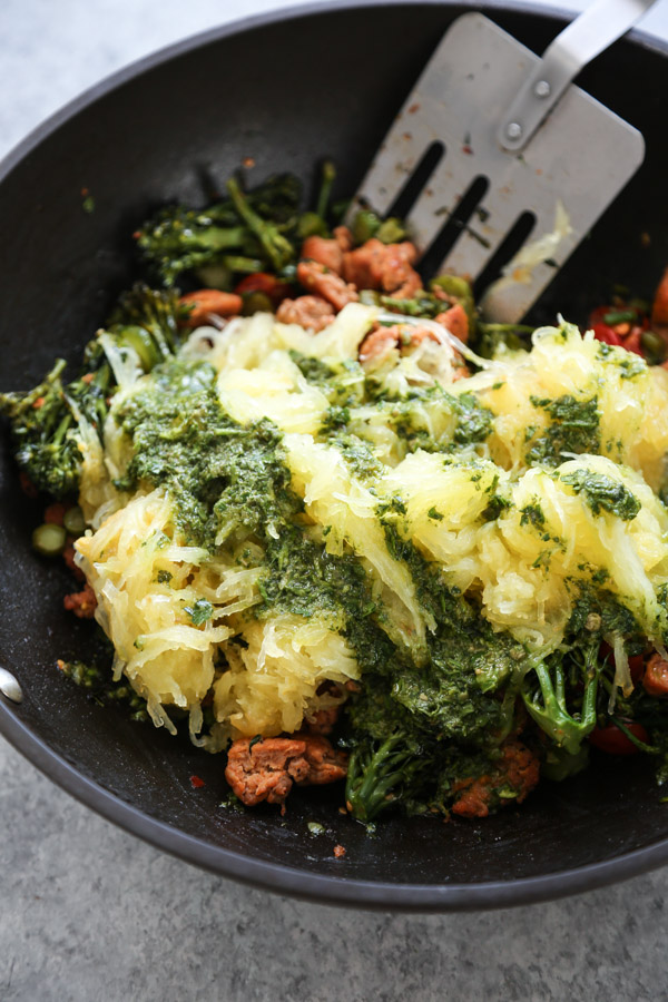 spaghetti squash spaghetti with green sauce in a skillet