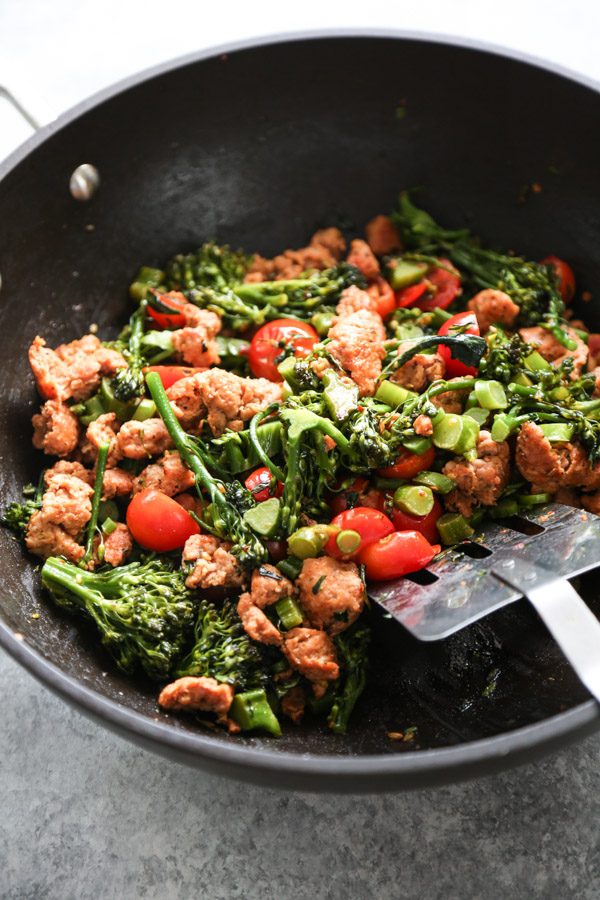 sausage tomatoes and broccoli in a skillet