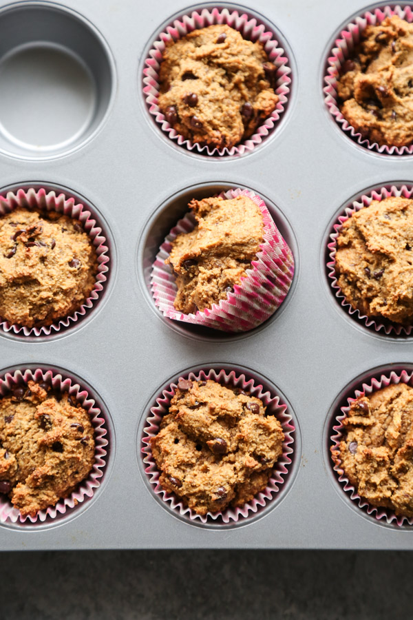 pumpkin chocolate chip muffins in a muffin tin