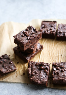 stack of brownies on parchment paper board