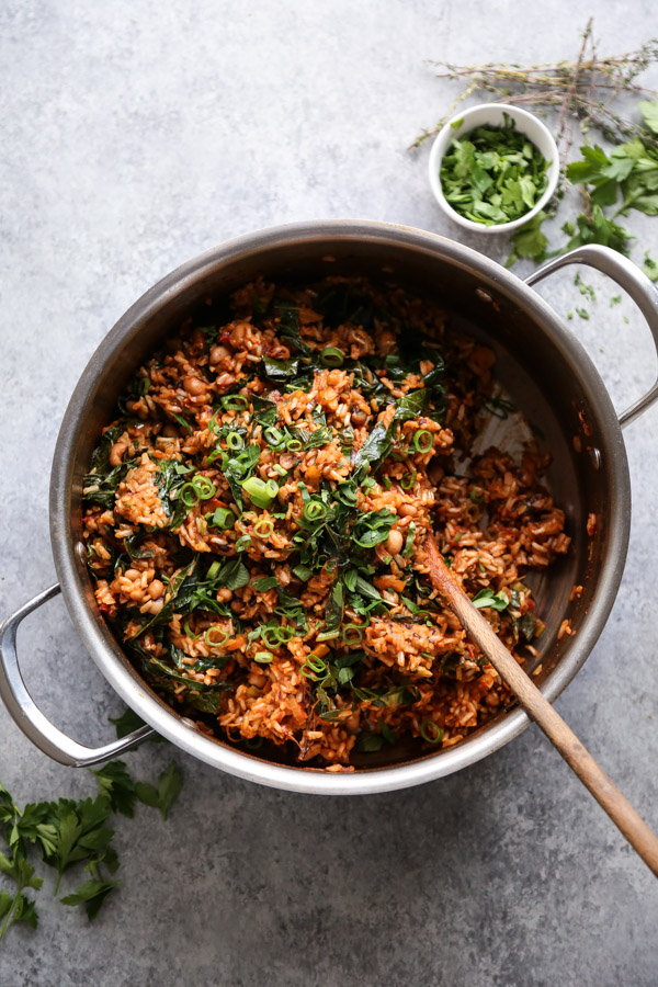 jambalaya with greens in a pot
