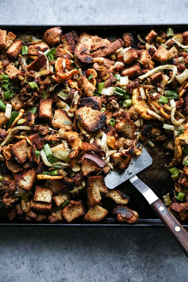 sheet pan thanksgiving stuffing with spatula
