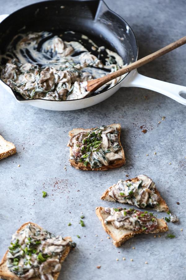 pan of creamy mushrooms and toast