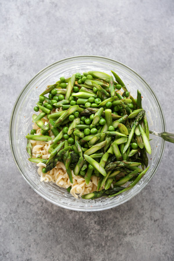 asparagus and spring vegetables in a bowl with pasta