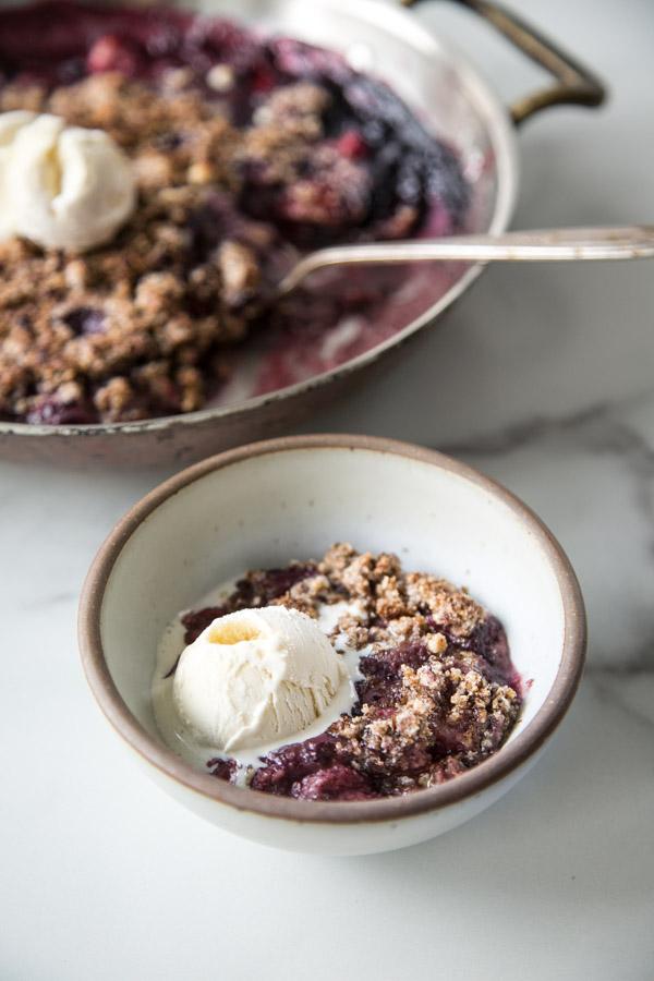 mixed berry crisp with ice cream