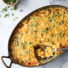 corn pudding with scallions in a casserole pan